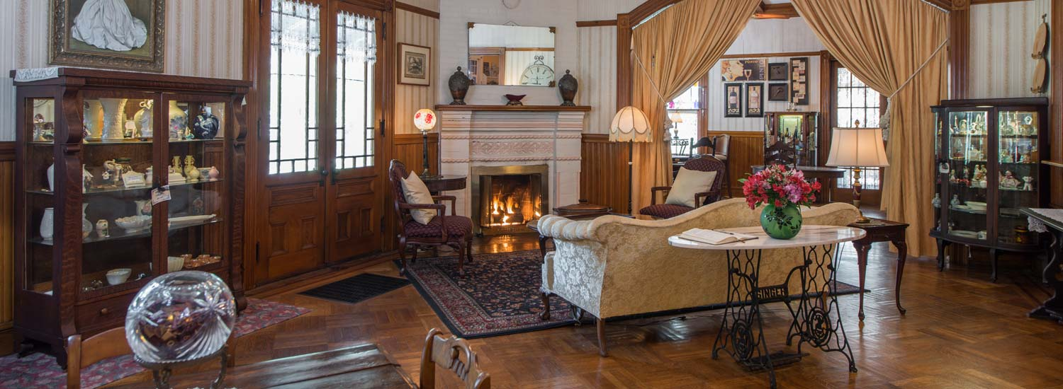 Great Room with Cozy Fireplace - About Lamplight Inn
