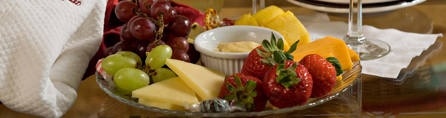 cheese and fruit platter at at Lamplight Inn Bed & Breakfast near Lake George